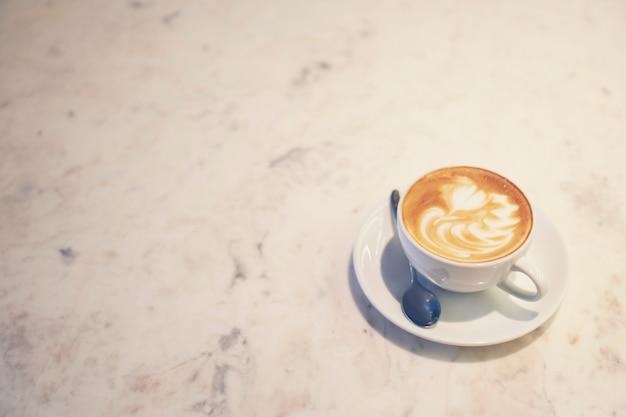 Coffee latte art, vintage filter image Premium Photo