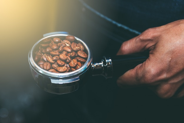 The coffee maker holds a device that contains coffee beans. Premium Photo