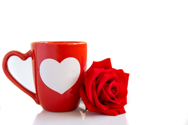 A coffee mug and a red rose Premium Photo