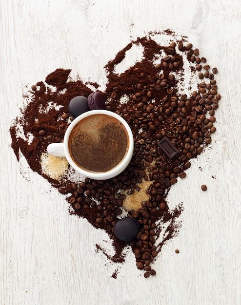 Coffee mug with coffee beans Free Photo