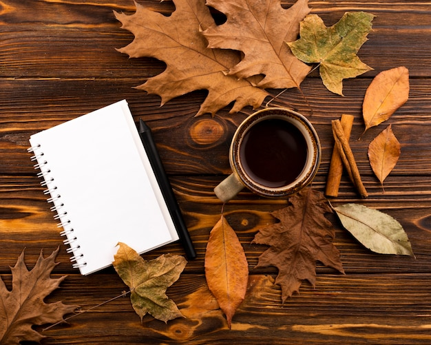Coffee and notebook on wooden background Free Photo
