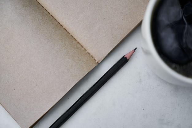 Coffee and notebook Premium Photo