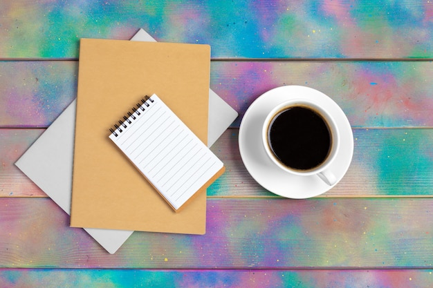Coffee, notepad and corporate documents, top view Premium Photo