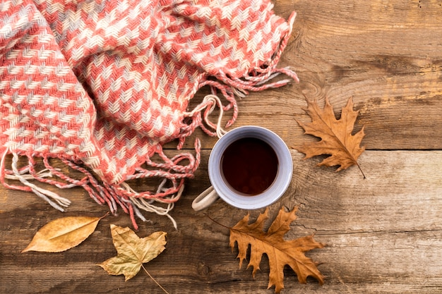 Coffee and scarf on wooden background Free Photo