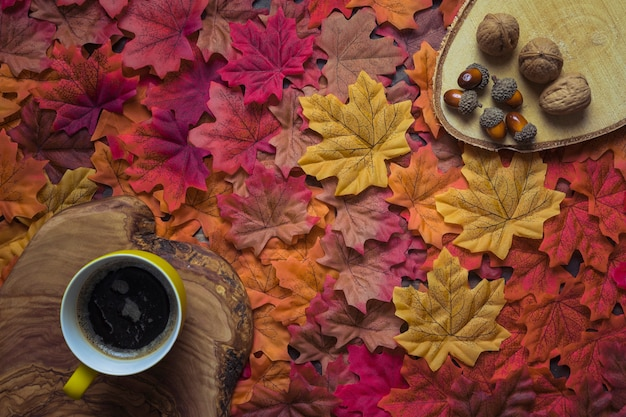 0889d68bbb1 Coffee set with autumn leaves and nuts Photo | Free Download