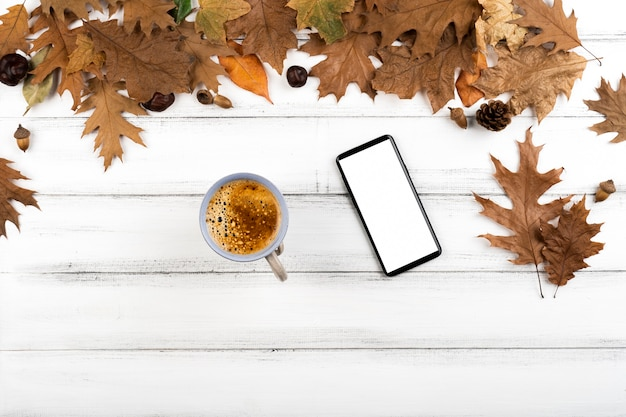 Coffee and smartphone layout on leaves background Free Photo