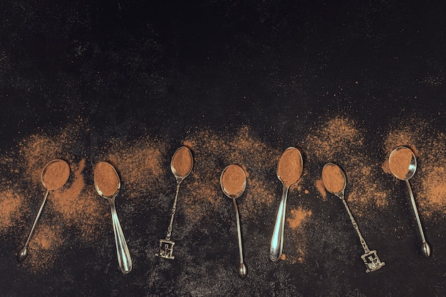 Coffee spoons on black background Free Photo