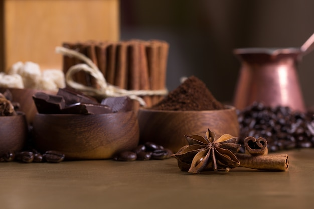 Coffee table with coffee beans and aromatic ingredients Premium Photo