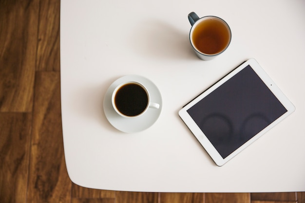 Coffee and tea on table Free Photo
