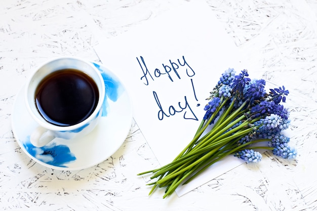 Coffee on white background and flowers. spring. morning. march 8. women's day Premium Photo