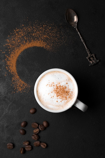 Coffee with milk and powder of coffee Free Photo