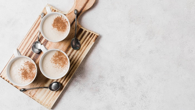 Coffee with milk on wooden board with copy space Free Photo