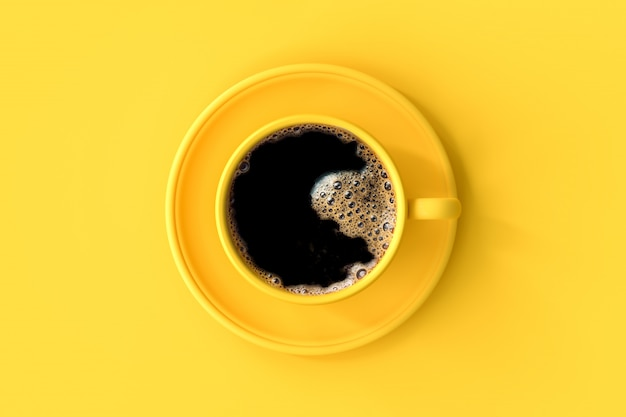 Coffee in yellow cup. Premium Photo