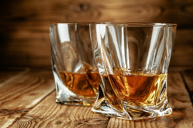 Cognac or whiskey in glasses Premium Photo
