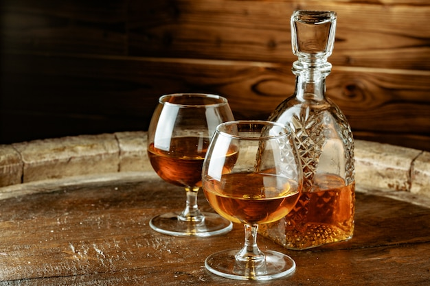 Cognac or whiskey in glasses Premium Photo