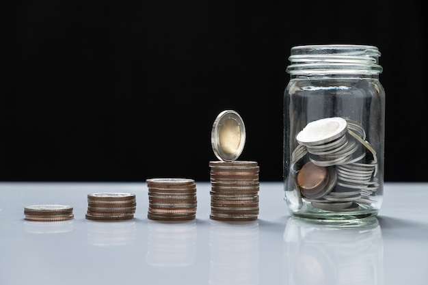 coin piles and glass for investment in the future Free Photo