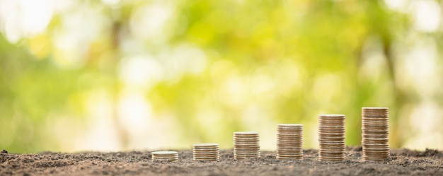 Coin stack on blur background. business success or money growing concept Premium Photo