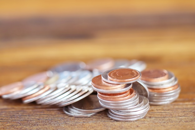 Coin on wood background Premium Photo