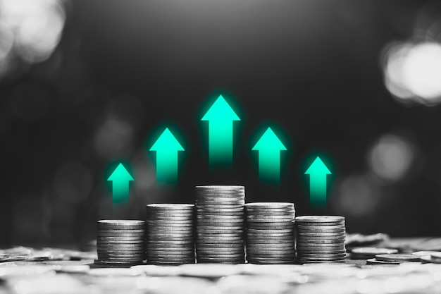 The coins are stacked with green technology icons at the top, financial growth concepts. Premium Photo