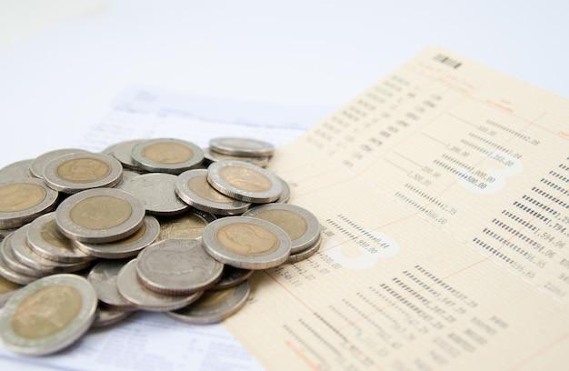 Coins over bill Premium Photo