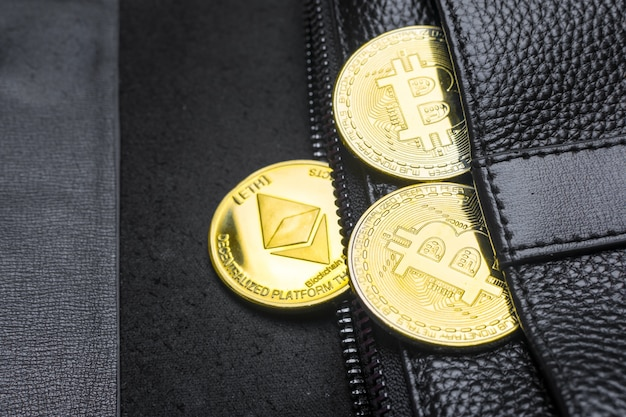 Coins bitcoin (btc), in wallet. blockchain.intarnational currency. top view. e-business. flat lay Premium Photo