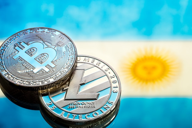 Coins bitcoin and litecoin, against the background of argentina flag, concept of virtual money, close-up. conceptual image. Free Photo