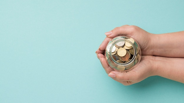 Coins in glass jar with copy space Free Photo
