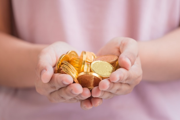Coins in hand Premium Photo