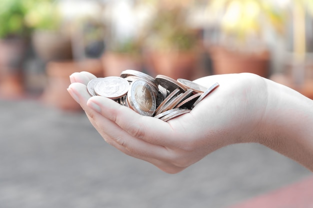 Coins in hands saving,donation investment fund financial support charity  dividend market  house stock trust wealthy giving planned accounting collection debt banking roi Premium Photo