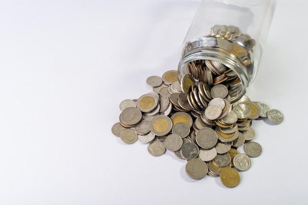 Coins in a jar Premium Photo