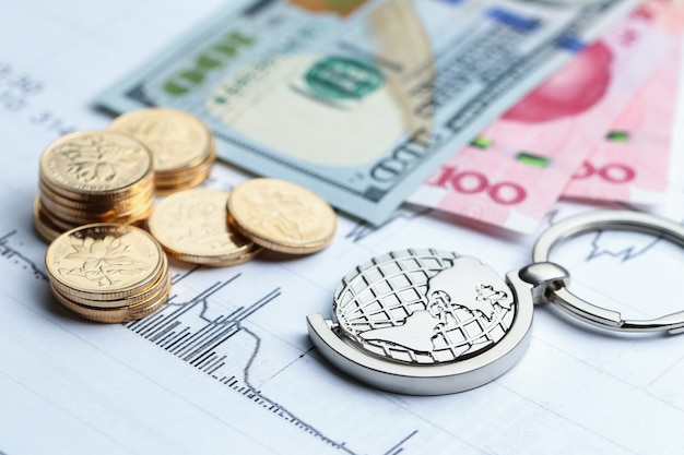 Coins, paper money and globe on white statistic form background Free Photo