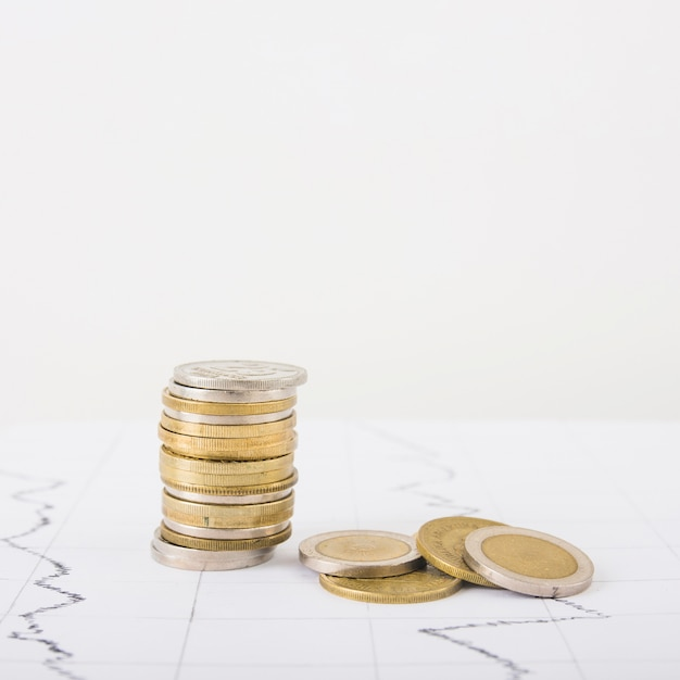 Coins stack on whitetable Free Photo