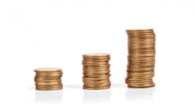 Coins stacked on each other in different positions b Premium Photo