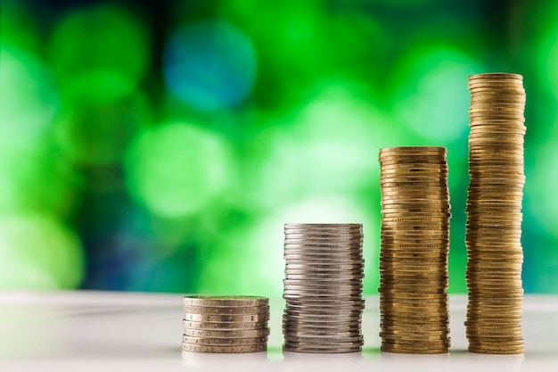 Coins stacks with green background. Premium Photo