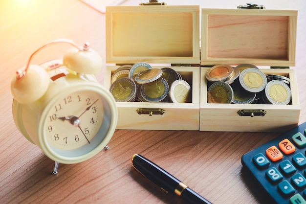Coins on the table in his office in finance, investment, saving and banking concept. Premium Photo
