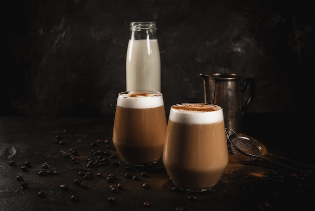 Cold coffee latte with milk, ice and cinnamon Premium Photo