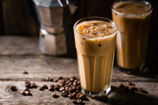 Cold coffee with ice and cream Free Photo