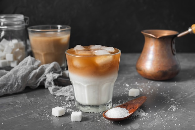 Cold coffee with ice cubes on a table Free Photo