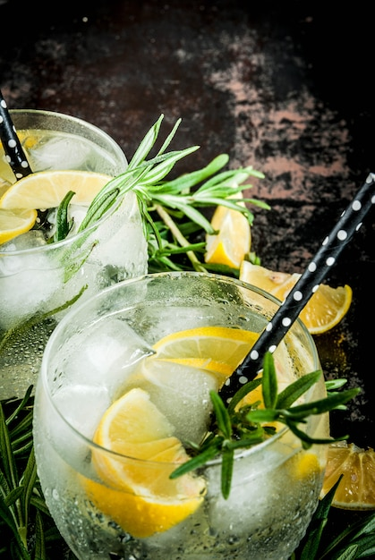 Cold drink with lemon and rosemary Premium Photo