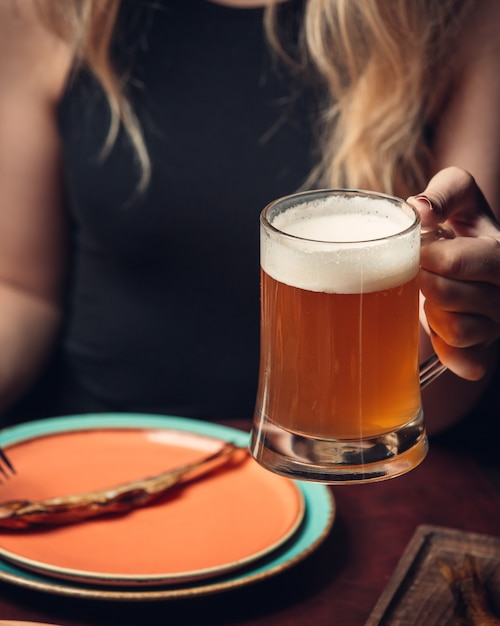 Cold filtered beer with foam Free Photo