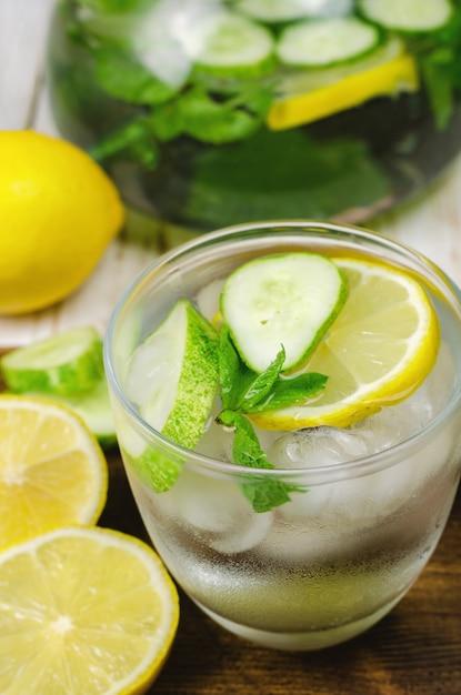Cold lemonade with lemon, mint and cucumber. Premium Photo