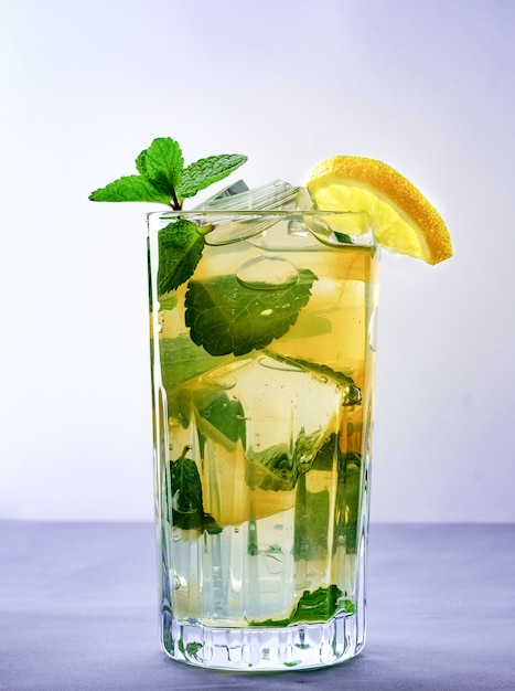 Cold refreshing summer lemonade in a glass on a grey background Premium Photo