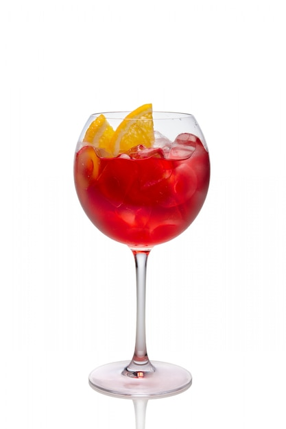 Cold sangria in a wine glass isolated on white. Premium Photo