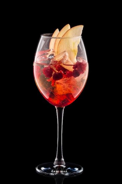 Cold sangria in a wine glass Premium Photo