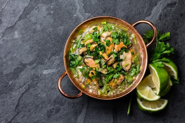 Cold soup with seafood and lemon Premium Photo