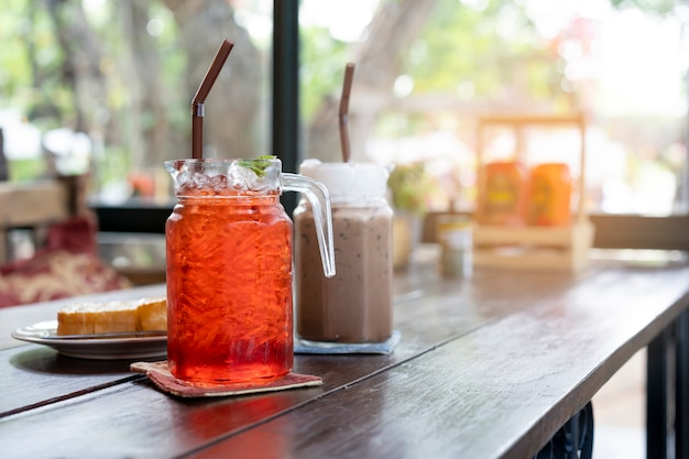 Cold tea drinks are placed on the table in the restaurant. Premium Photo