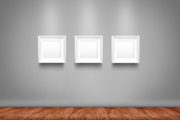 Collage of three white photo frames on the wall Premium Photo