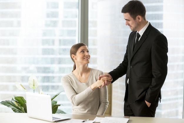 Colleagues congratulating each other with success Free Photo