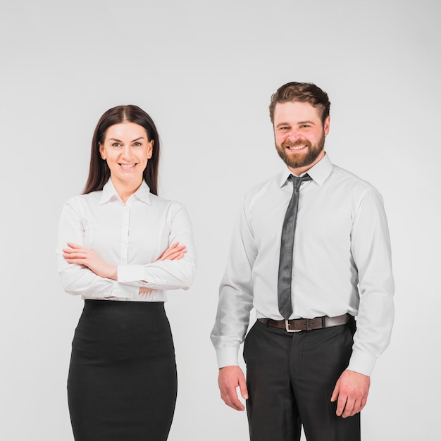 Colleagues man and woman standing together Free Photo