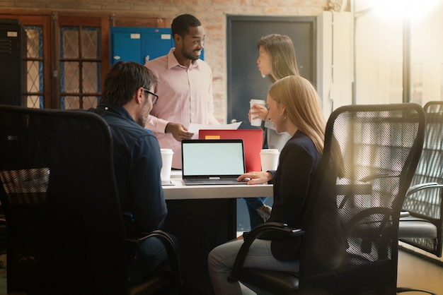 Colleagues working in modern office space Premium Photo